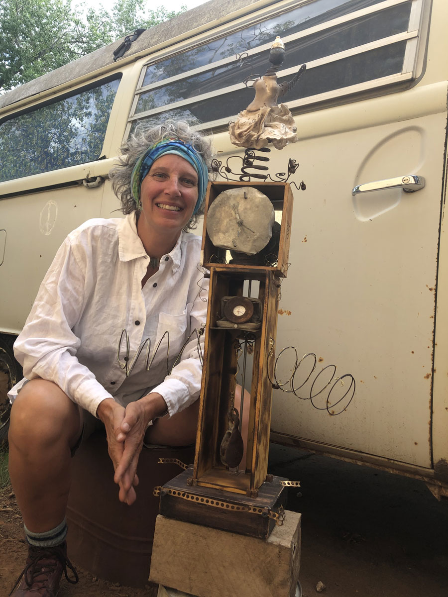 Jodie Atherton with sculpture next to vintage van